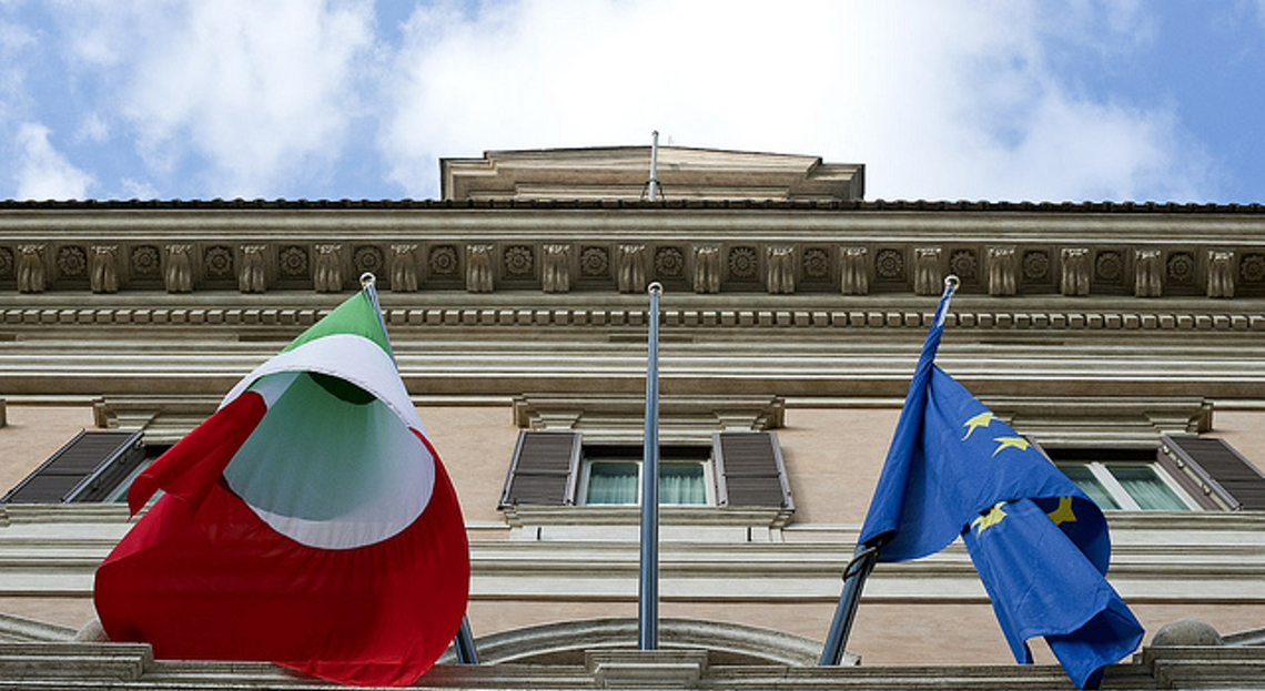 Building with EU and Italian flag