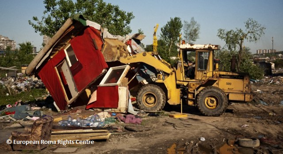 Bulldozer destroying settlement