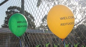 "2 balloons that say ""refugees welcome"""