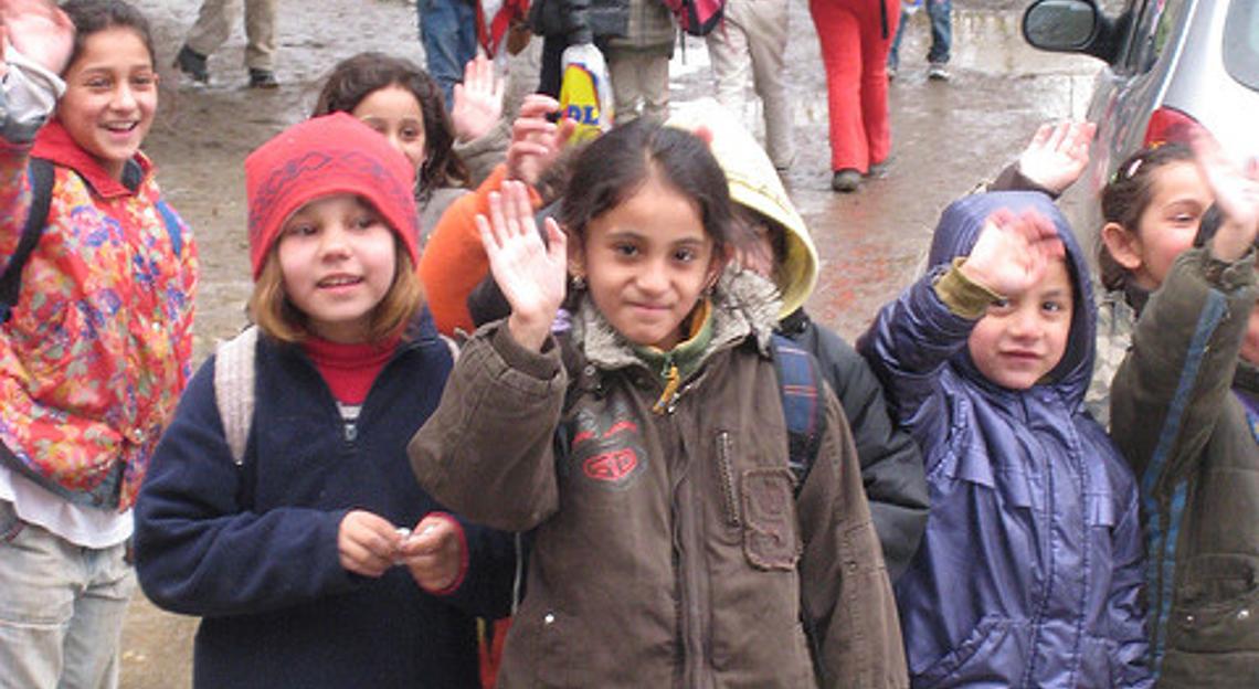 Roma children waving