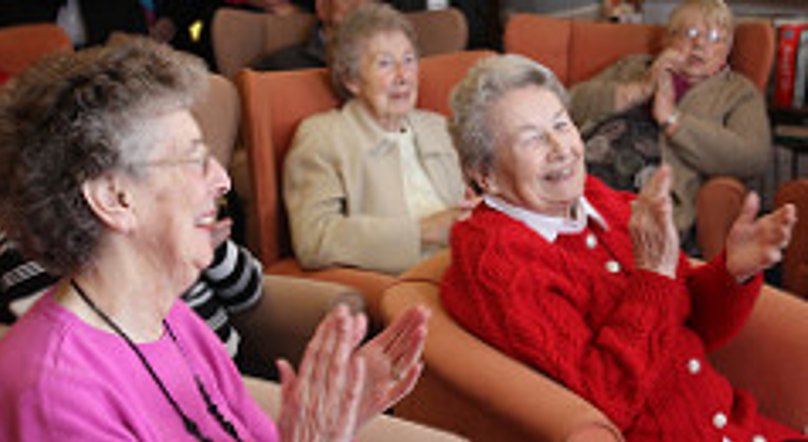 Old ladies clapping and smiling