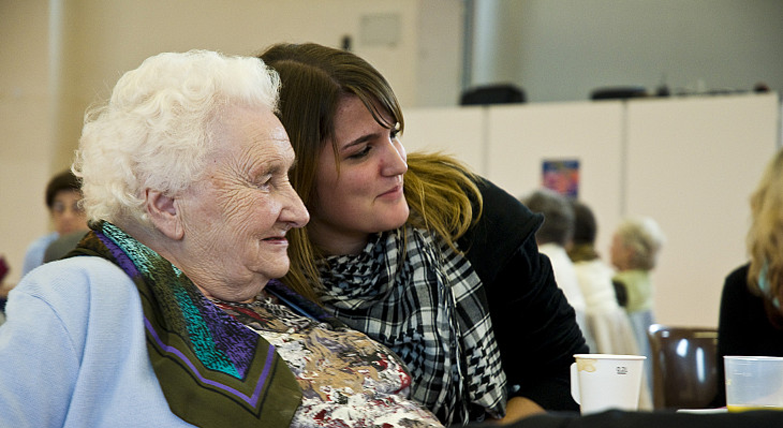 An old woman and a young woman hugging