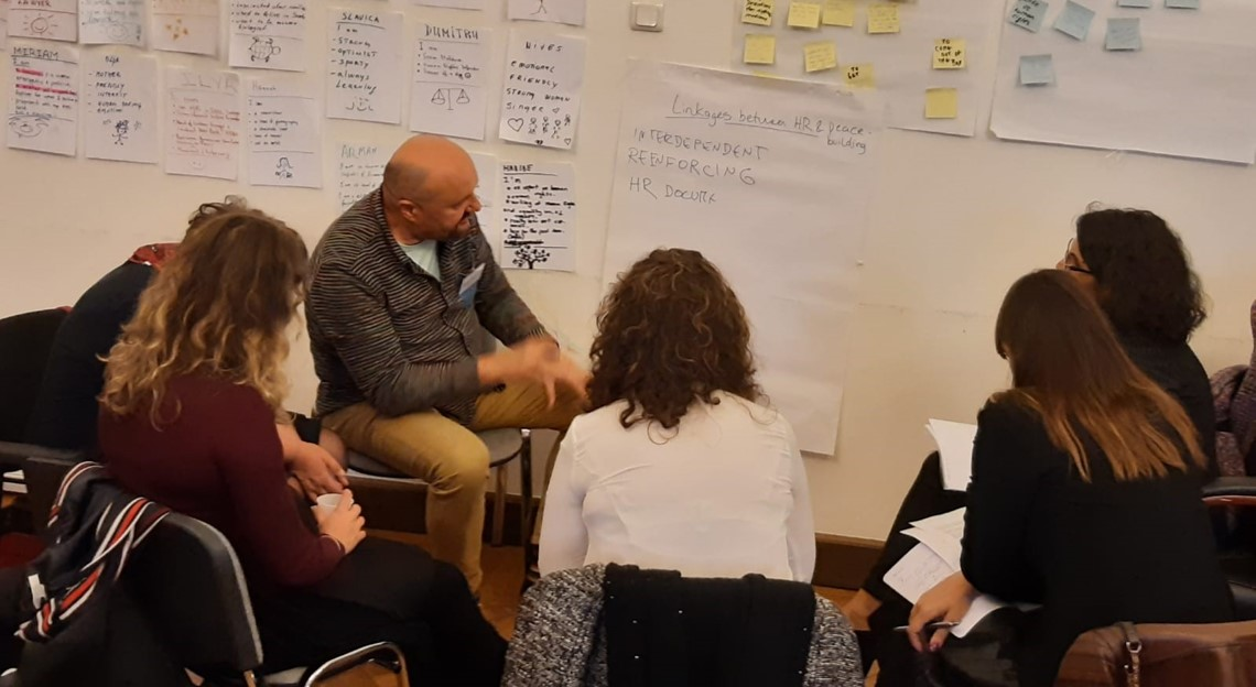 Participants in a discussion at workshop