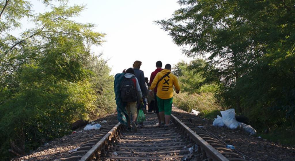 Men walking on a railway